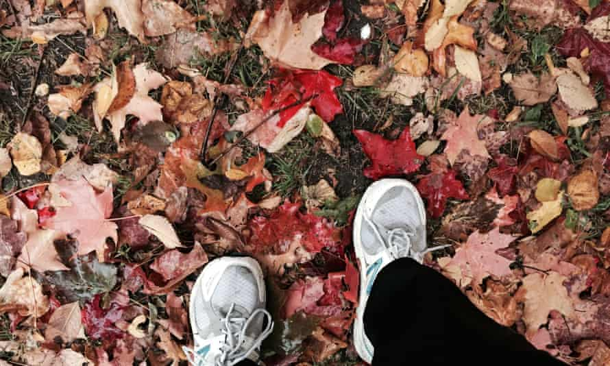This Wednesday, Oct. 28, 2015 photo shows a jogger poised for a run in Prospect Park, in Brooklyn, N.Y., on a path covered with colorful autumn leaves. Novice runners who begins training in middle age must overcome fears of injury and the humiliation of being passed by younger, fitter millennials every time they go out on a run. (AP Photo/Beth J. Harpaz)