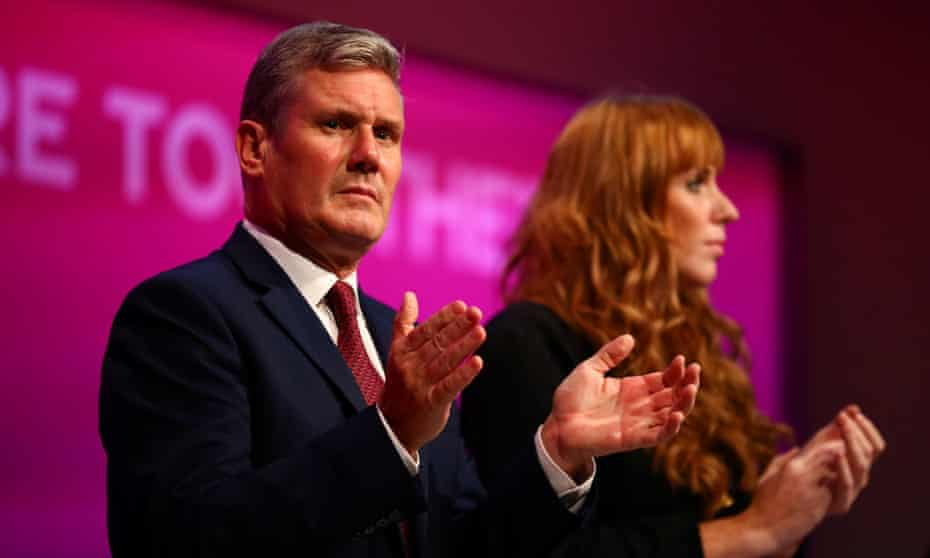 Labour party leader Keir Starmer and deputy leader Angela Rayner clap during the party's annual conference, in Brighton on 25 September.