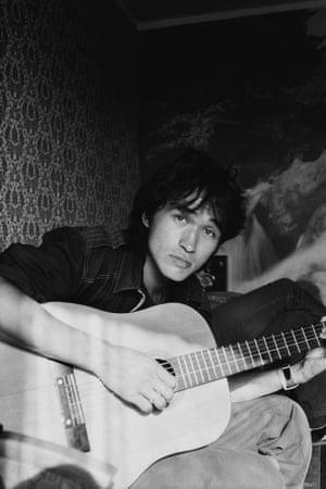A man playing a guitar