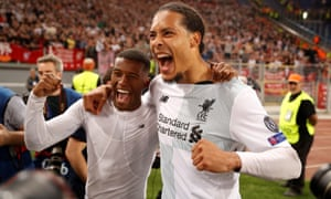 Liverpool's Virgil van Dijk and Georginio Wijnaldum celebrate after the match.