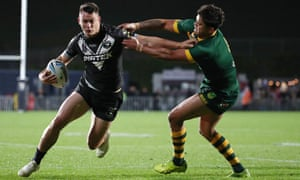 Joseph Manu of New Zealand is tackled by Latrell Mitchell of Australia during the trans-Tasman rugby league international.
