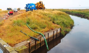 Tankers removing contaminated water in the Swalecliffe Brook, near Whitstable, in 2014. Southern Water was fined £500,000 for polluting the sea and the Kent stream.