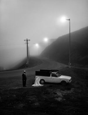 Majid Khaleghi Moghaddam - 2nd place winner, Single Image PrayerA couple stops along the roadside at the time of prayer in Iran. The husband is waiting for his wife to finish her prayer.