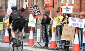 A cyclist shows his support to protesters at County Hall in Preston. The report's release comes days after Lancashire council rejected the UK's biggest fracking bids so far.