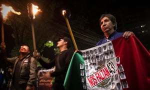 Residents and relatives of the 43 students from the Ayotzinapa teacher training College hold a protest in Mexico City.