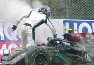 Russell appears to slap Bottas on his helmet