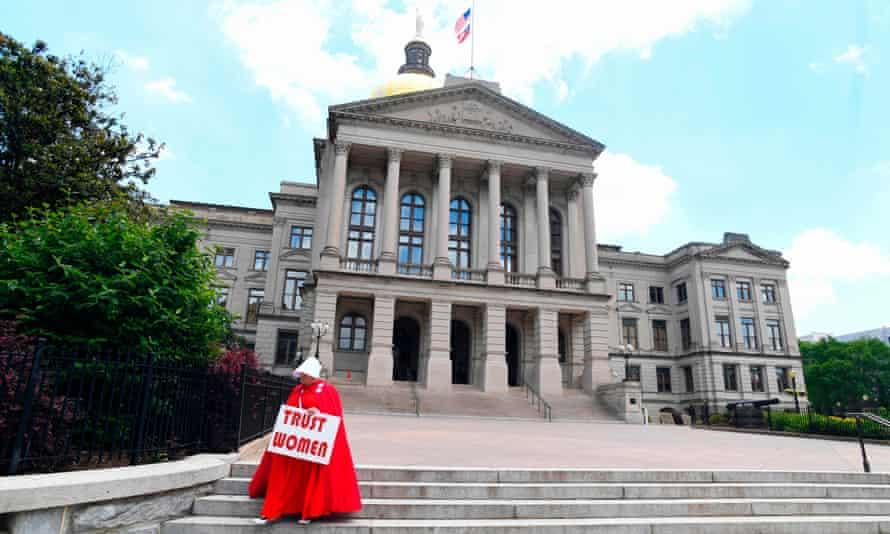 An activist, Tamara Stevens, leaves the Georgia capitol after an event opposing abortion legislation.