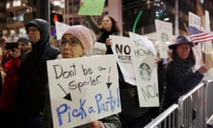 People protest Howard Schultz's possible presidential run in Seattle, Washington. 'I just don't think another rich person running for office is going to inspire a whole lot of excitement,' said Blake Gerald.