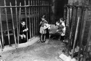 Children in an east London slum in 1954