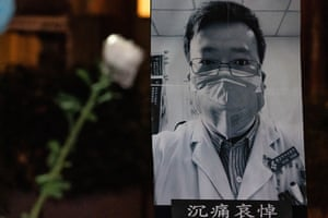 Flowers with a poster of whistleblower Dr Li Wenliang