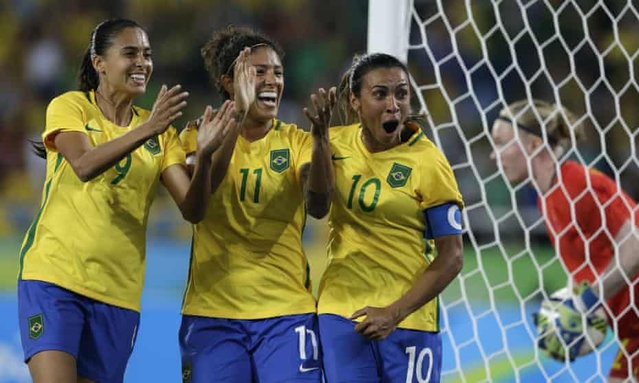 Brazil's Andressa Alves, left, Cristiane, center, and Marta celebrate after their side's second goal during a group E match of the women's Olympic football tournament against Sweden in Rio De Janeiro.