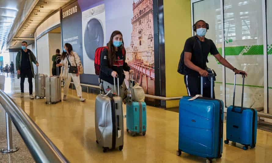 Travellers arrive in Lisbon, Portugal.