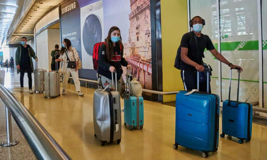 Travellers arrive at Lisbon airport
