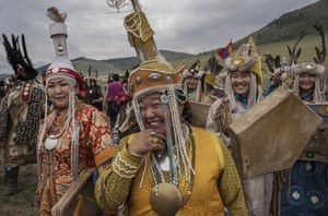 Shamans gather for a fire ritual intended to summon spirits. It is believed that shamans are chosen by their ancestral spirits to serve as a conduit to the living world