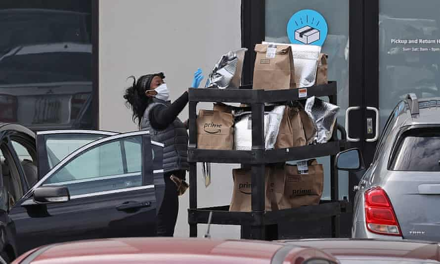 An Amazon Flex driver loads her personal vehicle with packages outside the 1.2m sq ft BWI2 Amazon fulfillment center in Baltimore, Maryland.
