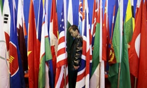 A staff member adjusts flags at the sixth Xiangshan forum in Beijing on Saturday. General Fan Changlong said China had done its 'utmost to avoid unexpected conflicts'.