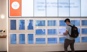 A customer picks up his order from computerized cubbies at Eatsa, an automated restaurant in San Francisco.