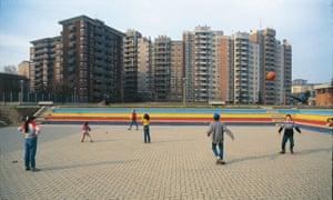 Children play in Sesto's Woods Island district.
