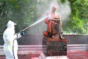 Milan, Italy, a municipal employee cleans a statue of Italian journalist Indro Montanelli after it was defaced