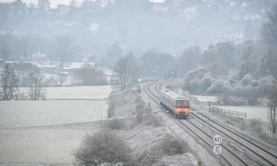 A train travels through rural Bath, as temperatures across parts of Britain dropped below freezing overnight.