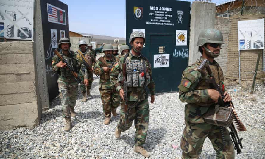 Afghan soldiers secure a military base that was used by US soldiers in Haska Meyna district of Nangarhar province, Afghanistan.
