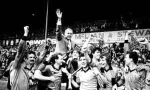 The Dundee United players and Jim McLean celebrate the club's first and only Scottish title victory.