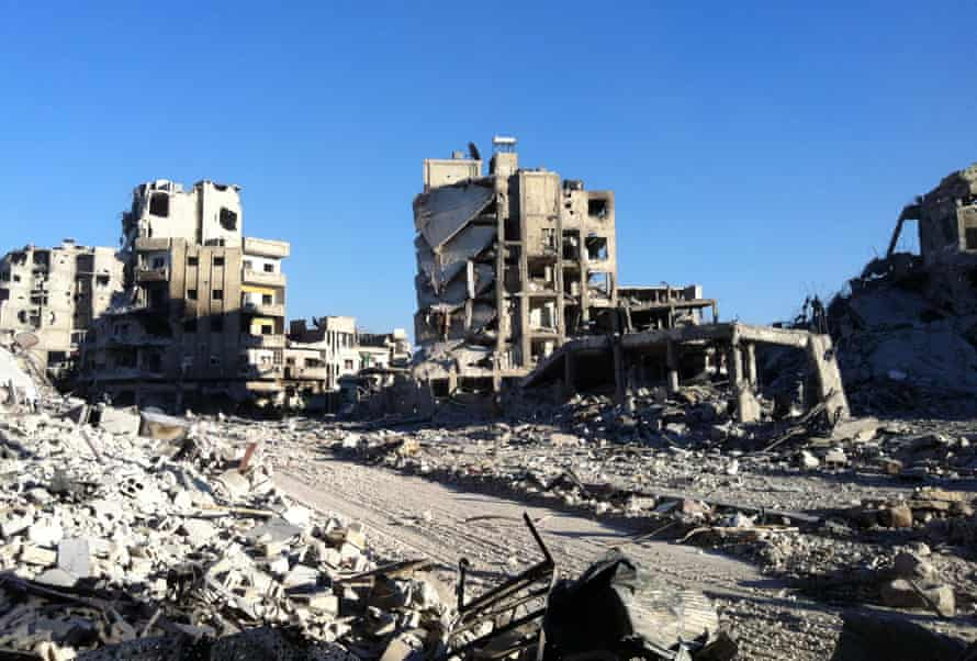Destroyed buldings in the Khaldiyeh district of Syria's central city of Homs, July 2013.