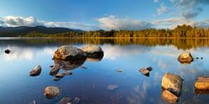 Still lake in early morning light, Loch Morlich, Cairngorms, Scotland
