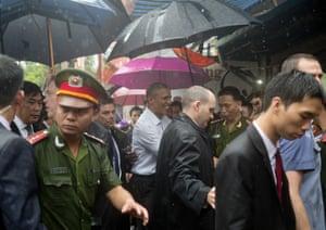 Hanoi, Vietnam: U.S. President Barack Obama braves the rain in a shopping area in Hanoi