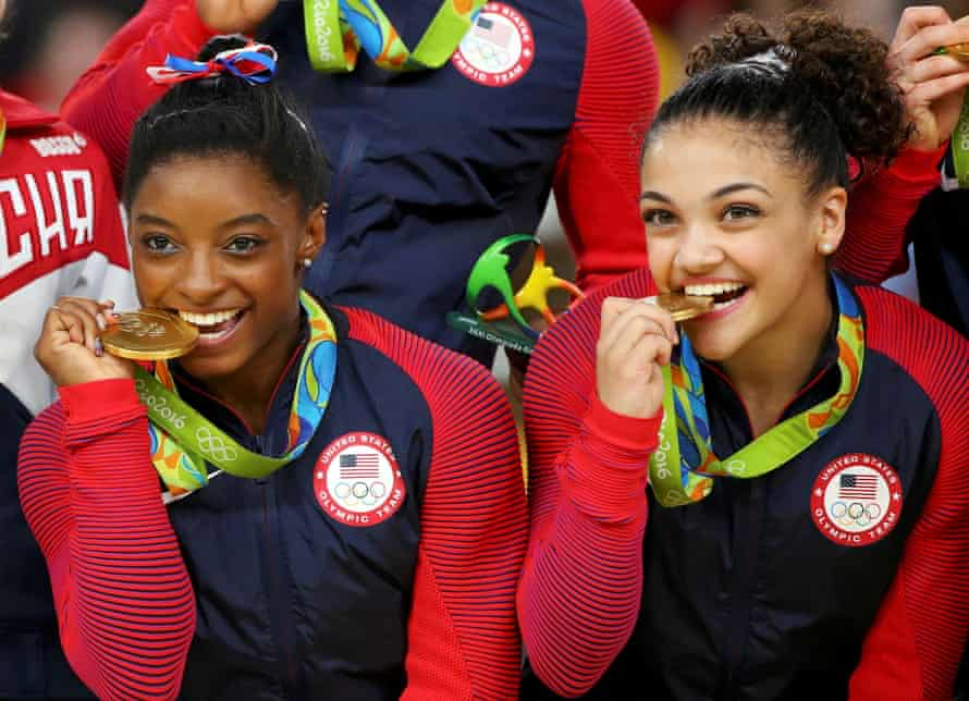 Simone Biles and Laurie Hernandez celebrate with team gold in Rio