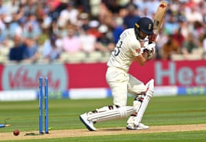 Mark Wood of England is bowled by Matt Henry for a lively 41.