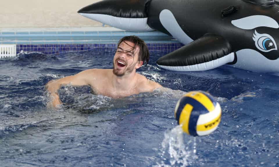 Jack Grealish in a swimming pool with an inflatable