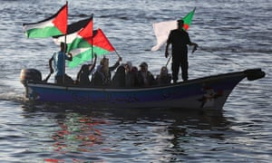 People from Gaza take to the water to protest against the interception of the Dutch-registered vessel