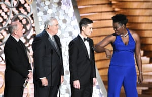 Leslie Jones with representatives of Ernst & Young onstage at the Emmys