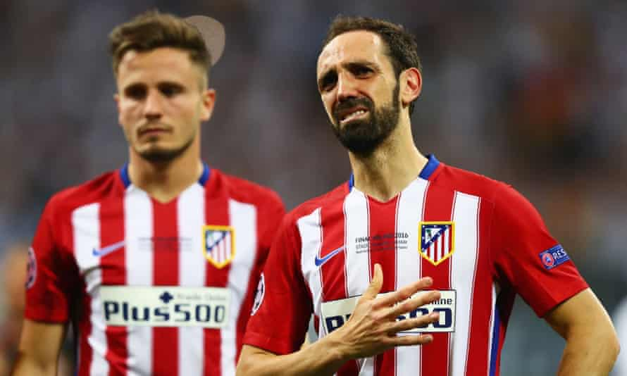 Juanfran, right, missed the decisive penalty for Atlético but there was no reproach from their supporters.
