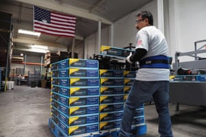 A worker stacks packaged Beautyrest bed frames at the Hollywood Bed Frame Company factory in Commerce, California.
