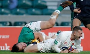 England's Jonny May celebrates after scoring their first try,