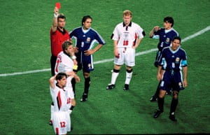David Beckham is sent off by Kim Milton Nielsen after kicking out at Diego Simeone.