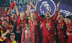 Jordan Henderson and his Liverpool team celebrate after getting their hands on the Premier League trophy.