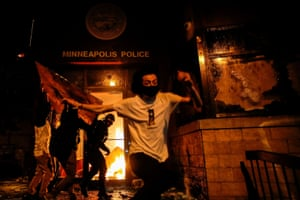Protesters set fire to the entrance of a police station