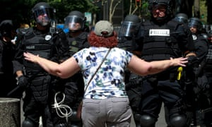 A counterprotester argues with police in Portland, Oregon.