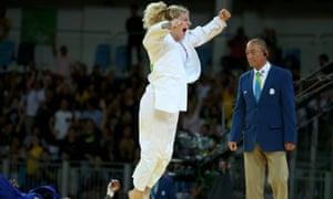 Kayla Harrison celebrates winning the gold medal.