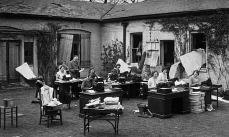 Typists at work in Regents Park, London, during the second world war after a bombing raid destroyed their office. Photograph: Getty