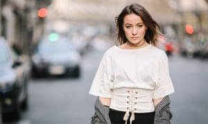 Model Amelie Lloyd wears a lace corset top during Paris fashion week.