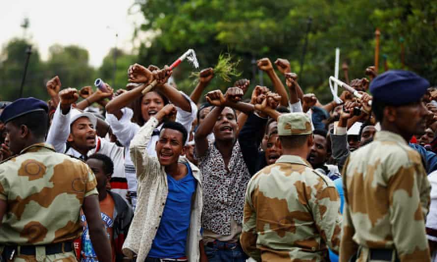 Demonstrators chant slogans during the Irreecha festival in Bishoftu