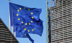European Union flags fly near the seat of the European Commission at the Berlaymont building in Brussels