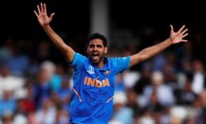 India's Bhuvneshwar Kumar celebrates taking the wicket of Australia's Steve Smith.