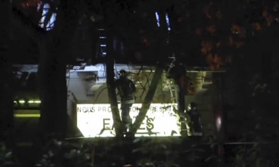 Video grab of French firefighters climbing ladders to rescue hostages at the Bataclan concert hall.