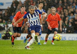 Brighton and Hove Albion's Neal Maupay scores their second goal from the penalty spot.