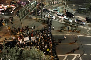 Demonstrators face off against New York police officers as they try to block an entrance to the Holland Tunnel.